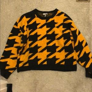 a plaid sweater (yellow and black so fashion)